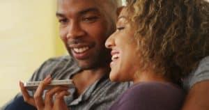 couple-using-iphone-speakerphone-voice-commands-shutterstock-510px