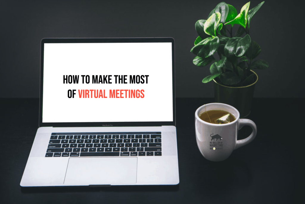 """Blank laptop screen, cup of tea, and desk plant. Text on screen, """"How to Make the Most of Virtual Meetings"""""""